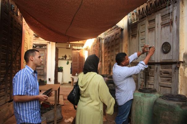 Rabha and Omar help Hicham learn the basics of photography on Anou.