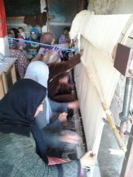 The women recorded that it took a total of 280 hours of weaving time to complete their Beni Ourain rug.