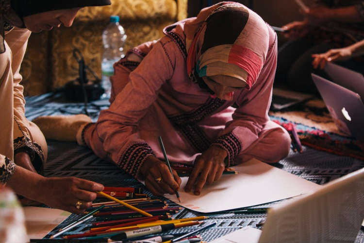 The artisans then selected five of their favorite colors from their favorite photo found on Pinterest and used them to create their color board.  Here, Fatima of the Imelghaus Cooperative creates her color board.