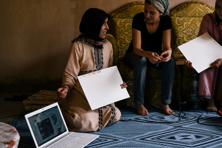 After selecting the images and their colors, each artisan explains their selection to everyone else. Here, Fatima Ouakhoum of the Cooperative of Imelghaus explains her choices.