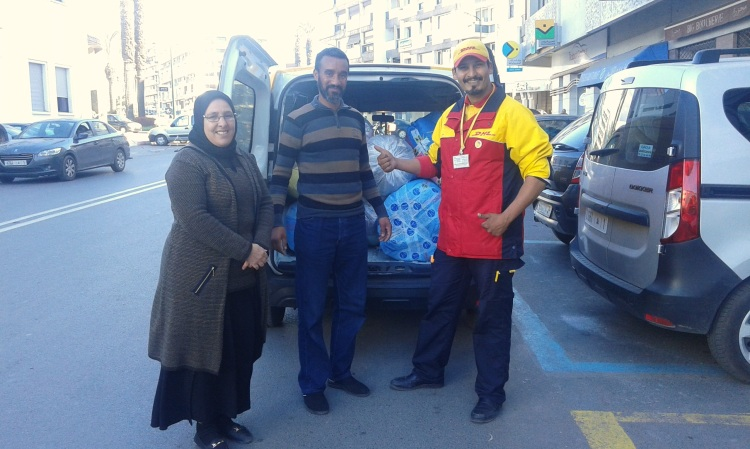 Abdullah, DHL's amazing courier, picks up shipments from Anou's office.